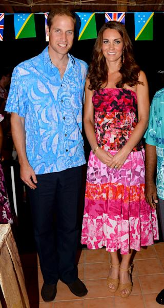 Britain's Prince William, left, and wife Kate, the Duchess of Cambridge, right, pose for a photo in Honiara, Solomon Islands, Sunday Sept. 16, 2012. The royal couple is on a nine-day tour of the Far East and South Pacific in celebration of Queen Elizabeth II's Diamond Jubilee. (AP Photo/William West, Pool)