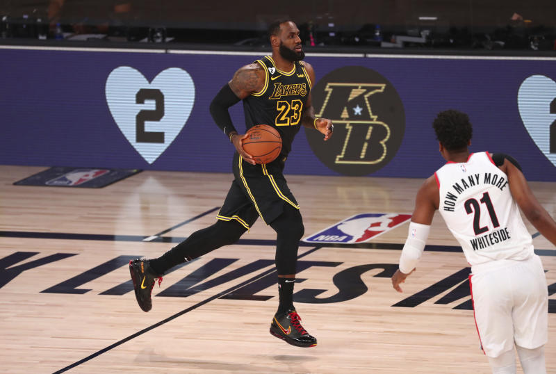 Los Angeles Lakers forward LeBron James (23) drives downcourt against the Portland Trail Blazers in Game 4 of an NBA basketball first-round playoff series, Monday, Aug. 24, 2020, in Lake Buena Vista, Fla. (Kim Klement/Pool Photo via AP)