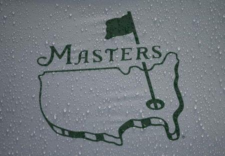 Rain falls onto the logo on a Masters unbrella during a players practice round ahead of the 2015 Masters at Augusta National Golf Course in Augusta