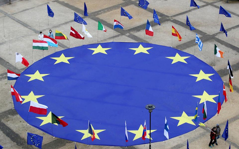 A large European Union flag lies at the centre of Schuman square, outside the European Commission headquarters