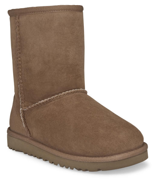 """This undated image provided by Ugg, shows a Classic Short Ugg boot in Chestnut color. A closet full of beautiful boots and gravity-defying heels, flat-foot, furry Uggs weren't at the top of celebrity stylist-designer Rachel Zoe's shopping list. But""""Once you put them on, you can't go back,"""" Zoe says. """"In my house, it's now the family at-home shoe. I wear them all the time. My son has 10 pairs and my husband has 10 pairs."""" (AP Photo/Ugg)"""