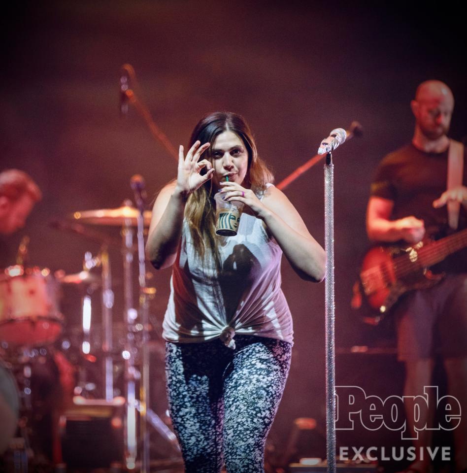 """<a href=""""https://people.com/tag/hillary-scott/"""">Hillary Scott</a> takes a quick caffeine break during rehearsals at the Palms Casino Resort's Pearl Concert Theater."""