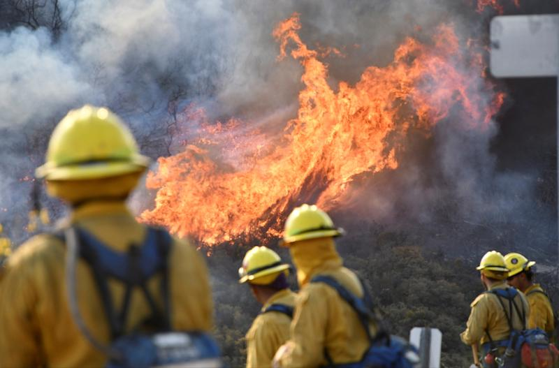 Firefighters attack the Thomas fire's northern flank near Ojai, California. (Gene Blevins / Reuters)