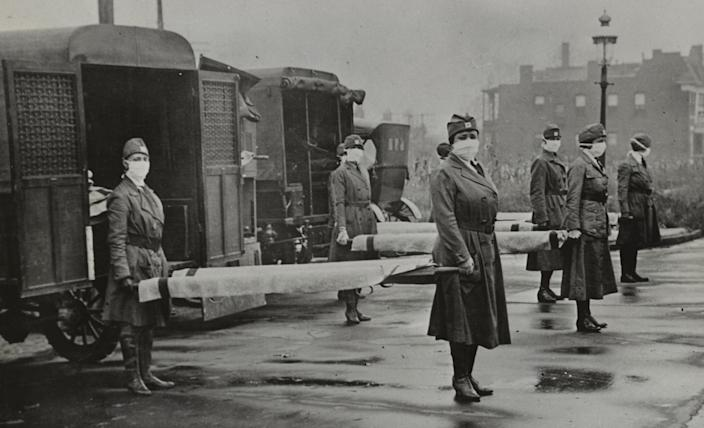 The St. Louis Red Cross Motor Corps during the 1918 flu epidemic. (Universal History Archive / Universal Images Group via Getty Images)