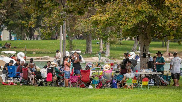 PHOTO: A large family has a picnic together as they join hundreds of people spreading out over Mile Square Park to celebrate Labor Day with their families, Sept. 7, 2020, in Fountain Valley, Calif. (Allen J. Schaben/Los Angeles Times via Getty Images, FILE)