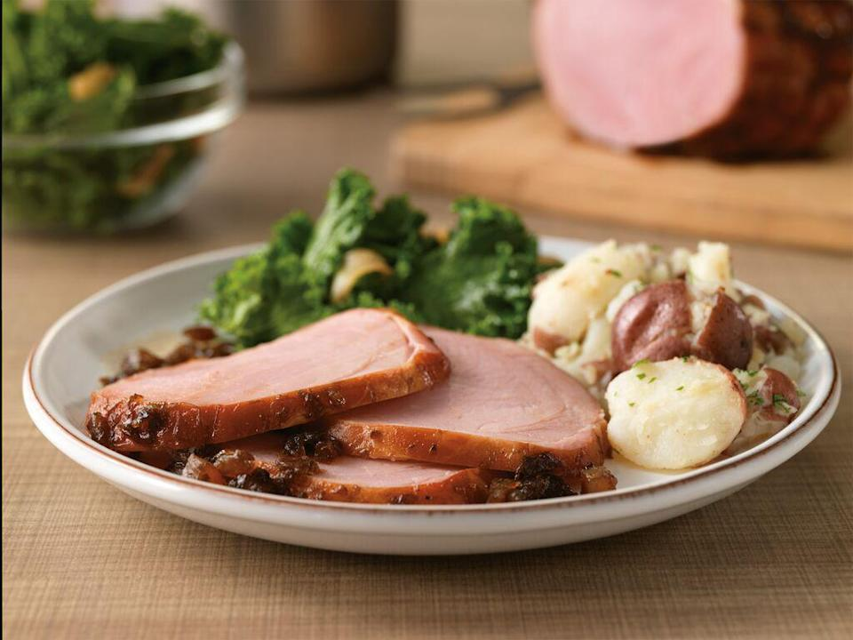 """<p>The addition of balsamic vinegar to a glaze gives this ham a delicate sweet and tart note. Trust us, you've never had a ham like this before.</p> <p><a href=""""https://www.thedailymeal.com/honey-ham-balsamic-easter?referrer=yahoo&category=beauty_food&include_utm=1&utm_medium=referral&utm_source=yahoo&utm_campaign=feed"""" rel=""""nofollow noopener"""" target=""""_blank"""" data-ylk=""""slk:For the Honey Balsamic-Glazed Ham recipe, click here."""" class=""""link rapid-noclick-resp"""">For the Honey Balsamic-Glazed Ham recipe, click here.</a></p>"""
