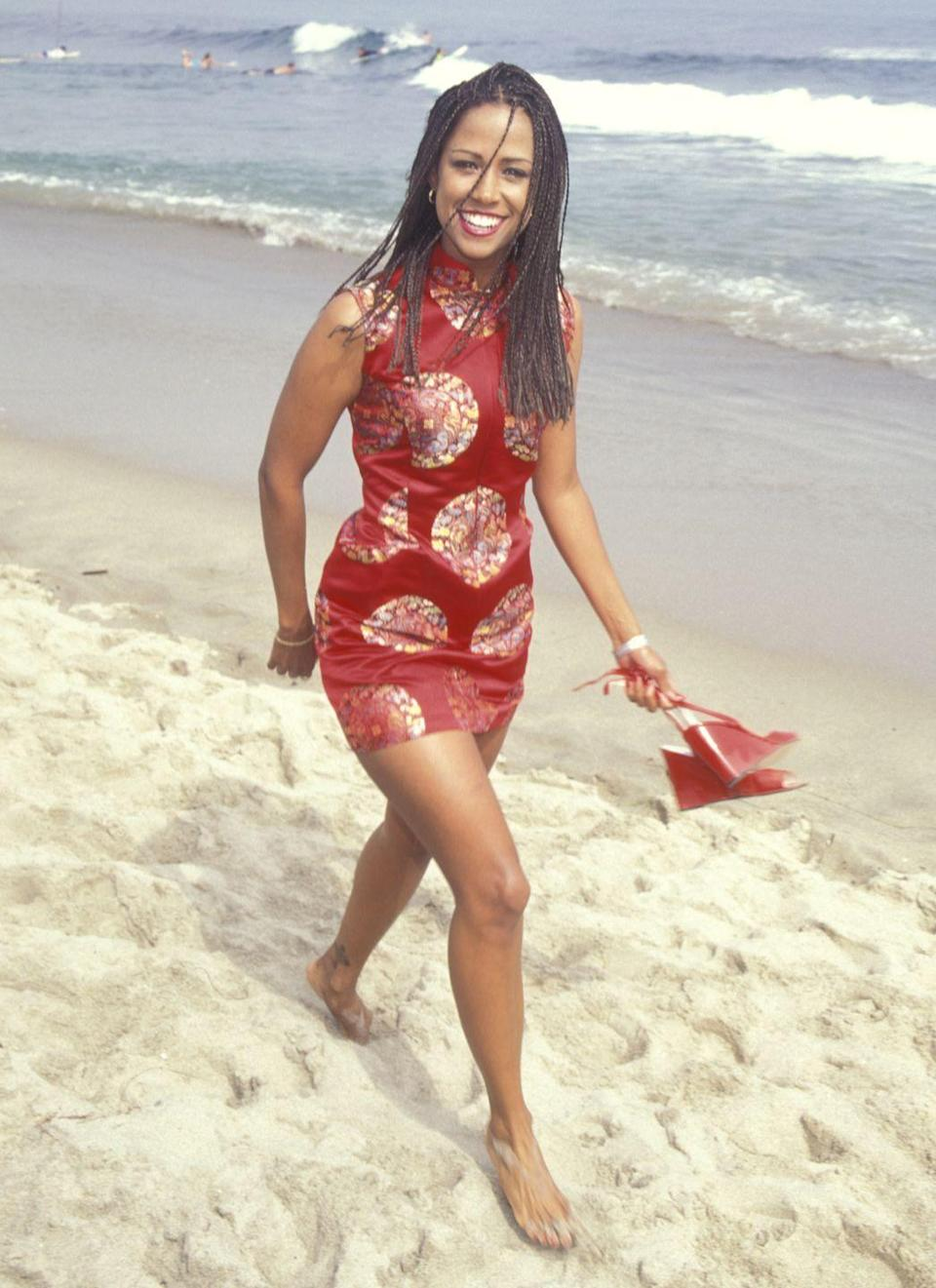 <p>Stacey Dash, who starred in <em>Clueless</em> as Dionne, chose a red printed minidress with a high neckline for the fête, but unlike Silverstone, her on-screen BFF, she kicked off her wedges and carried them around the screening.</p>