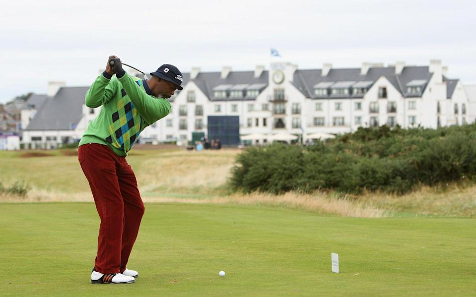 <p>Samuel L. Jackson plays off the 16th tee during the first round of the Alfred Dunhill Links Championship on October 2004.</p>