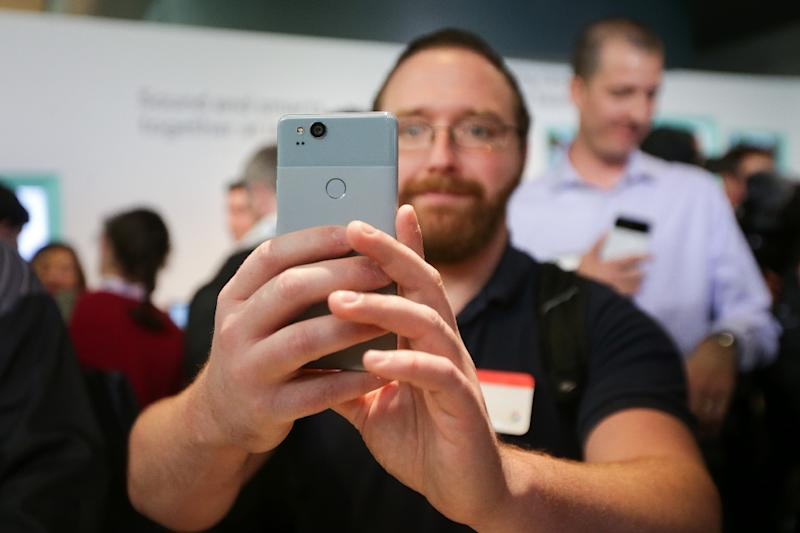 The 'barely blue' color model of the Pixel 2 smartphone at a product launch event in San Francisco, California