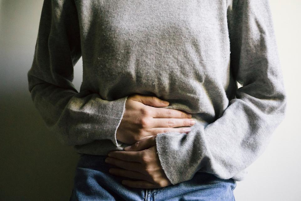 Woman suffering from stomach ache (Photo: Carlo107 via Getty Images)