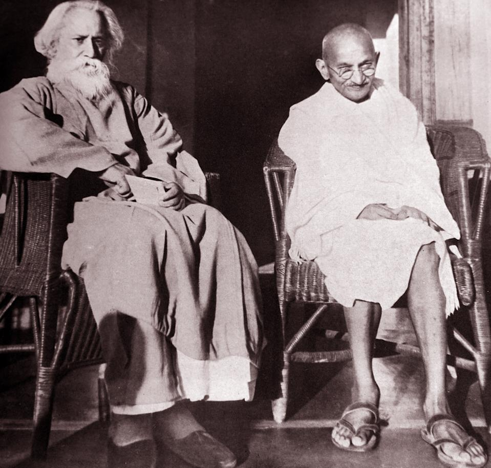 Mohandas Karamchand Gandhi (1869 - 1948) With Rabindranath Tagore at Santiniketan, 1940. Gandhi was the preeminent leader of the Indian independence movement in British-ruled India. Rabindranath Tagore (1861 -1941) was a Bengali polymath, philosopher and author. (Photo by: Universal History Archive/ Universal Images Group via Getty Images)