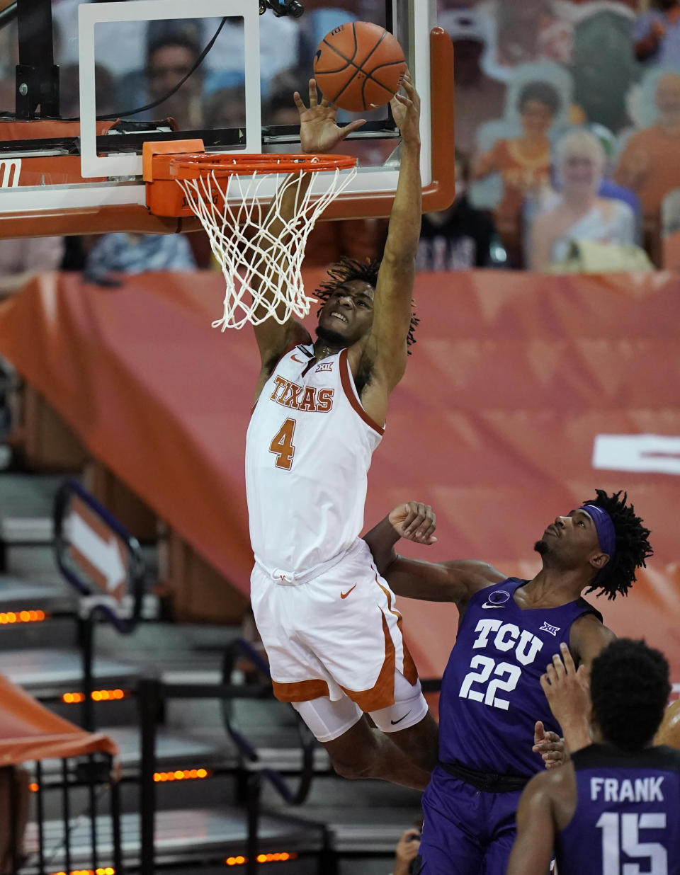 Texas forward Greg Brown (4) drives to the basket over TCU guard RJ Nembhard (22) during the second half of an NCAA college basketball game, Saturday, Feb. 13, 2021, in Austin, Texas. (AP Photo/Eric Gay)