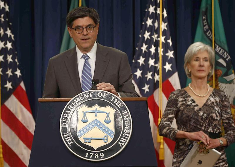 Treasury Secretary Jacob Lew, accompanied by Health and Human Services Secretary Kathleen Sebelius, speaks about Social Security and Medicare, Friday, May 31, 2013, at the Treasury Department in Washington. The government says Medicare's giant hospital trust will not be exhausted until 2026, while the date that Social Security will exhaust its trust fund is unchanged at 2033.  The date for Medicare is two years later than was projected last year.  (AP Photo/Charles Dharapak)