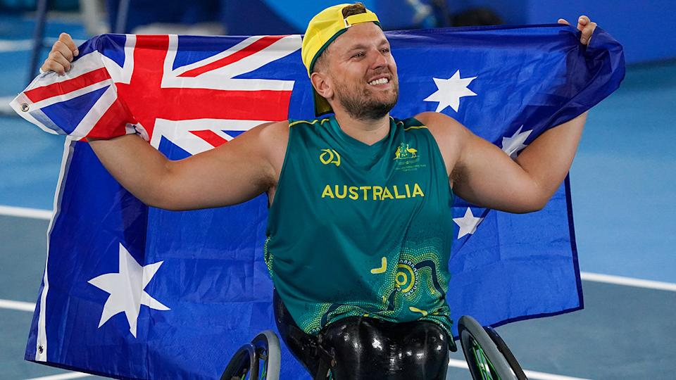 Dylan Alcott, pictured here after winning gold at the Paralympics.
