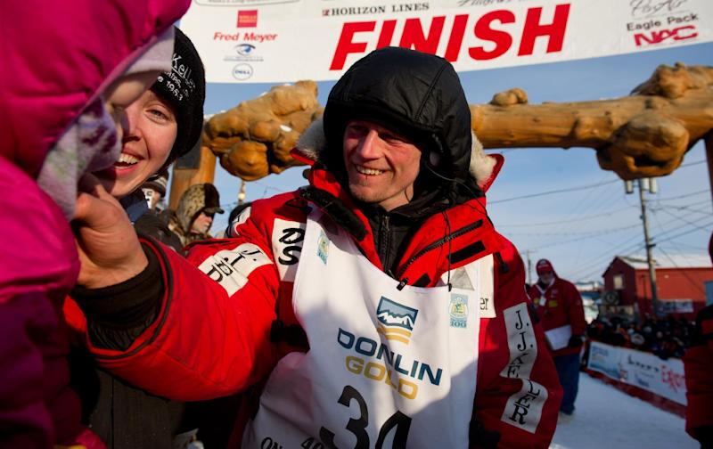 Dallas Seavey greets his daughter Annie and wife Jen under the burled arch. Seavey arrived at the finish line to claim victory in the Iditarod Trail Sled Dog Race in Nome, Alaska, on Tuesday, March 13, 2012. Seavey is the youngest musher to win the nearly 1,000-mile race across Alaska. (AP Photo/Marc Lester, Anchorage Daily News)