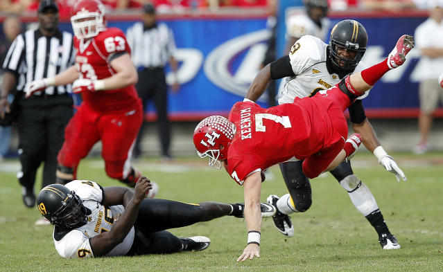 HOUSTON - DECEMBER 03: Quarterback Case Keenum #7 of the Houston Cougars is sacked by Cordarro Law #49 of the Southern Mississippi Golden Eagles in the fourth quarter at Robertson Stadium on December 3, 2011 in Houston, Texas. (Photo by Bob Levey/Getty Images)