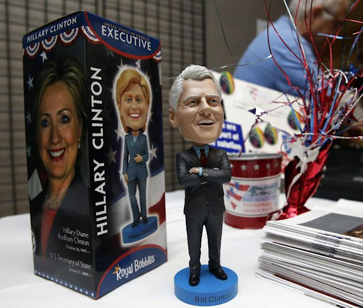 FILE - This July 13, 2013 file photo shows a vendor booth at the Massachusetts state Democratic Convention in Lowell, Mass., selling Bill and Hillary Clinton bobble head dolls. As Hillary Rodham Clinton privately weighs a second White House run, pieces of the Democratic establishment are beginning to fall into place publicly to help a possible candidacy. Several super political action committees are collectively acting as a de facto campaign organization to ensure she's ready to compete aggressively if she decides to try again to become the first woman president. (AP Photo/Michael Dwyer, File)