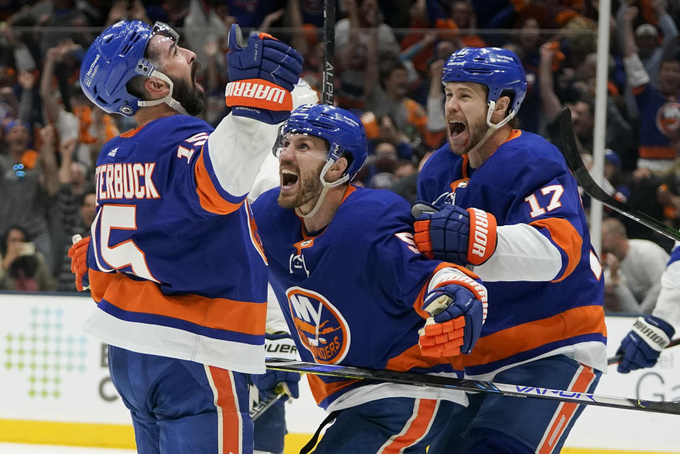 New York Islanders right wing Cal Clutterbuck (15) celebrates with teammates after scoring against the Tampa Bay Lightning during the second period of Game 3 of the NHL hockey Stanley Cup semifinals, Thursday, June 17, 2021, in Uniondale, N.Y. (AP Photo/Frank Franklin II)