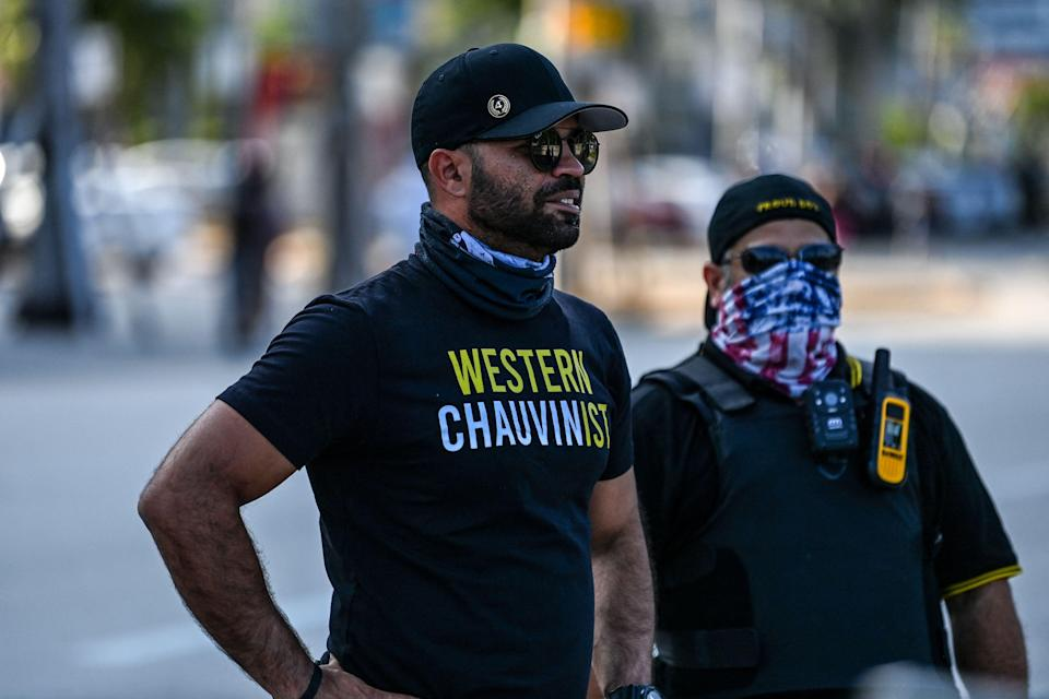 Enrique Tarrio, left, chairman of the Proud Boys, wears a shirt expressing support for Derek Chauvin in a counterprotest against a remembrance of George Floyd in Miami on May 25, the one-year anniversary of Floyd's death at the hands of police officer Chauvin.