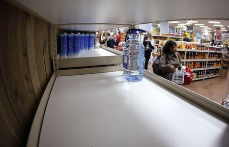 One bottle of water remains on the shelf at Trader Joe's supermarket in New York