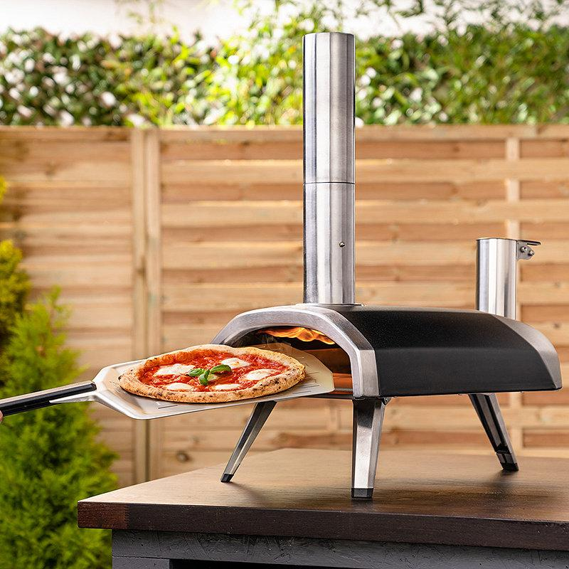 "<a href=""https://fave.co/3b4SDmF"" rel=""nofollow noopener"" target=""_blank"" data-ylk=""slk:Ooni Fyra Wood-Fired Outdoor Pizza Oven"" class=""link rapid-noclick-resp"">Ooni Fyra Wood-Fired Outdoor Pizza Oven</a>. (Ooni)"