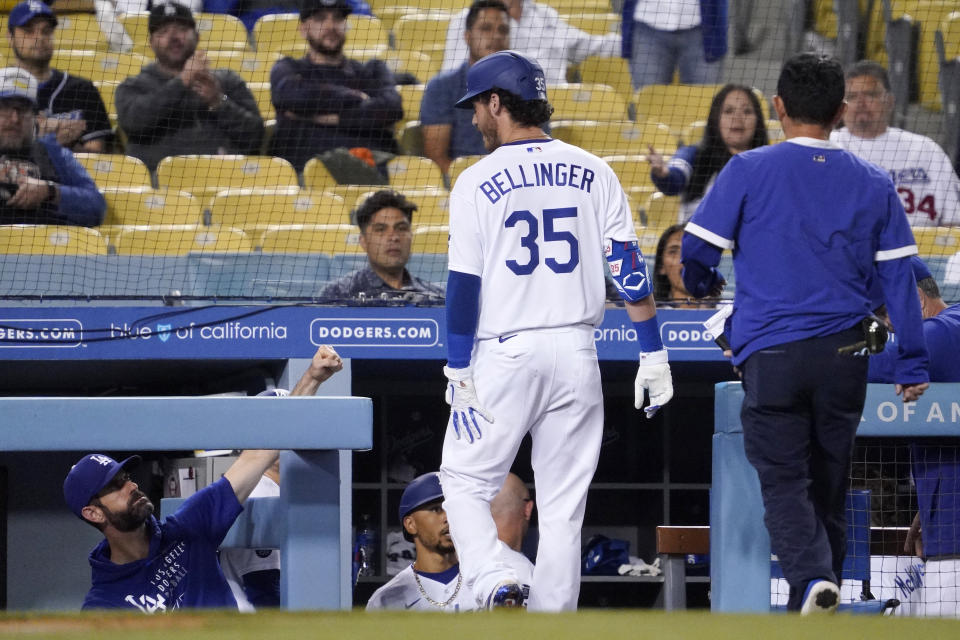 Los Angeles Dodgers' Cody Bellinger holds the back of his leg after being taken out of the game during the fifth inning of a baseball game against the Texas Rangers Friday, June 11, 2021, in Los Angeles. (AP Photo/Mark J. Terrill)