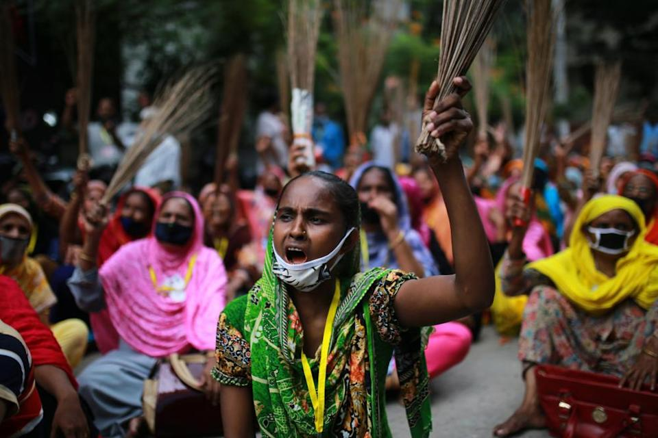 Garment workers protest demanding their due wages in front of the Labour Bhaban in Dhaka, Bangladesh on September 7, 2020.