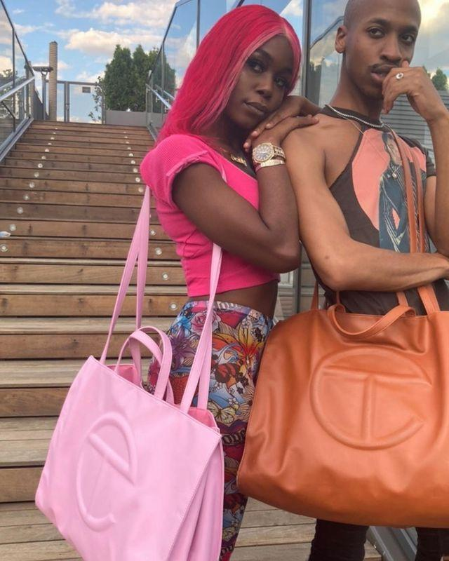 """<p>You might recognize Telfar as the Black-owned brand that broke the Internet this summer. Their bags are a big deal—and with limited drops that sell out almost immediately, it's akin to trying to snag a Birkin.</p><p><br><a class=""""link rapid-noclick-resp"""" href=""""https://www.telfar.net/"""" rel=""""nofollow noopener"""" target=""""_blank"""" data-ylk=""""slk:SHOP NOW"""">SHOP NOW</a></p><p><a href=""""https://www.instagram.com/p/CBiatg7lz0V/"""" rel=""""nofollow noopener"""" target=""""_blank"""" data-ylk=""""slk:See the original post on Instagram"""" class=""""link rapid-noclick-resp"""">See the original post on Instagram</a></p>"""