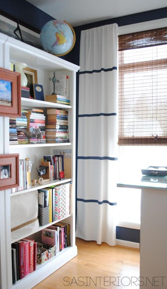 """<p>The trick to making perfect navy lines across an all-white curtain? Painter's tape of course. The same stuff that works on your walls will ensure the edges on your stripes are straight and the same size.</p><p><a href=""""http://www.jennaburger.com/2013/02/diy-how-to-hem-no-sew-and-add-stripes-to-curtains-using-paint/"""" target=""""_blank""""><em>Get the tutorial at Jenna Burger Design »</em></a></p>"""