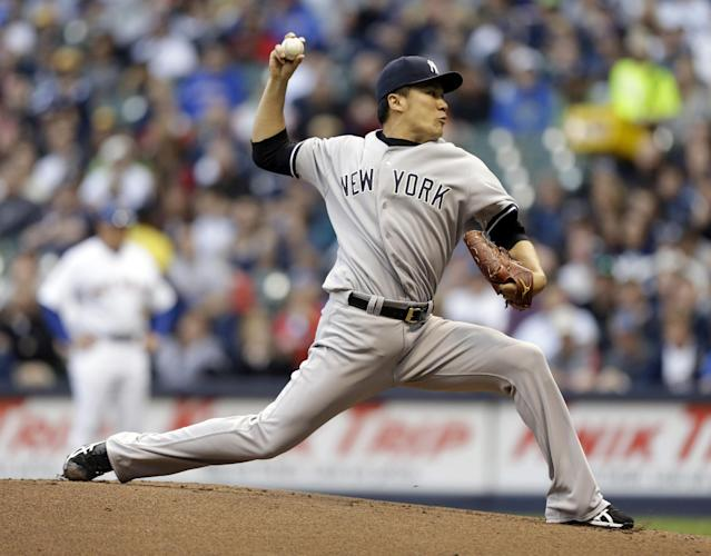 New York Yankees starting pitcher Masahiro Tanaka throws to the Milwaukee Brewers in the first inning of a baseball game Friday, May 9, 2014, in Milwaukee. (AP Photo/Jeffrey Phelps)