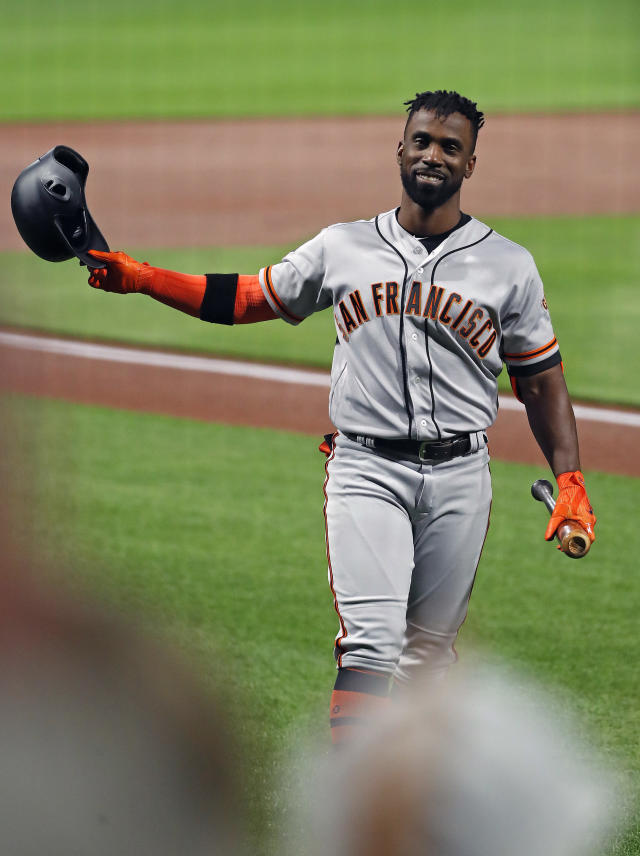 San Francisco Giants' Andrew McCutchen acknowledges fans as he walks to the batter's box during the first inning of the team's baseball game against his former team, the Pittsburgh Pirates, in Pittsburgh, Saturday, May 12, 2018. (AP Photo/Gene J. Puskar)