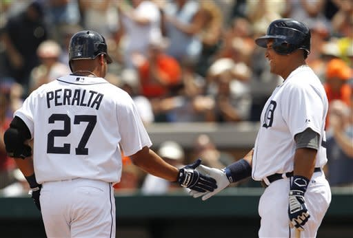Detroit Tigers shortstop Jhonny Peralta (27) is congratulated by teammate Miguel Cabrera after hitting a solo home run against the Houston Astros in the third inning during a spring training baseball game in Lakeland, Fla., Sunday, April 1, 2012. (AP Photo/Paul Sancya)