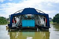 The Interceptor barge can collect up to 50 tons of waste a day
