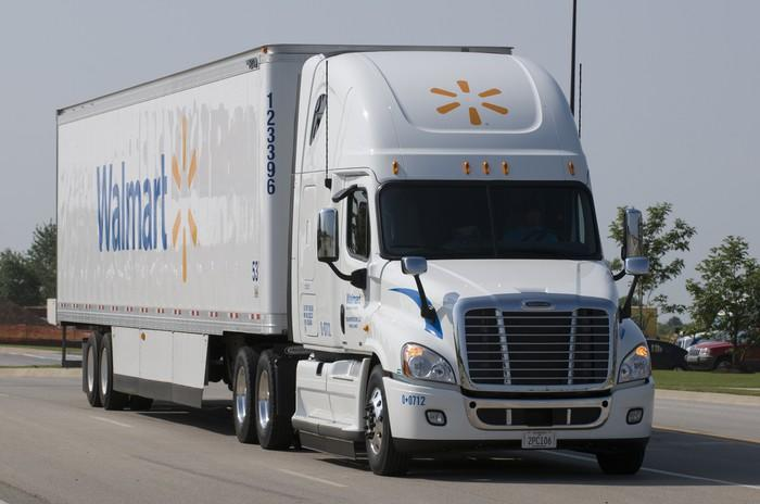 A Walmart truck on the highway.