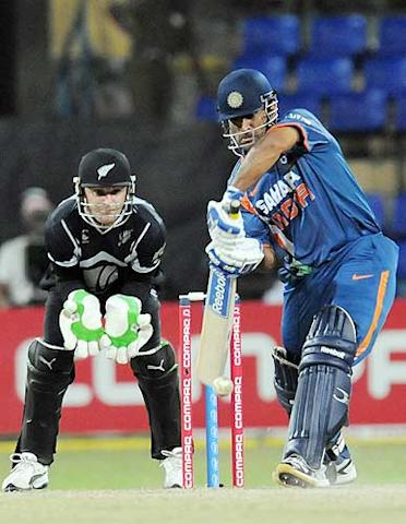 Mahendra Singh Dhoni (R) plays a stroke as Brendon McCullum looks on during the second match of the Compaq Cup between India and New Zealand at The R Premadasa Stadium in Colombo. (Lakruwan Wanniarachchi/AFP/Getty Images)