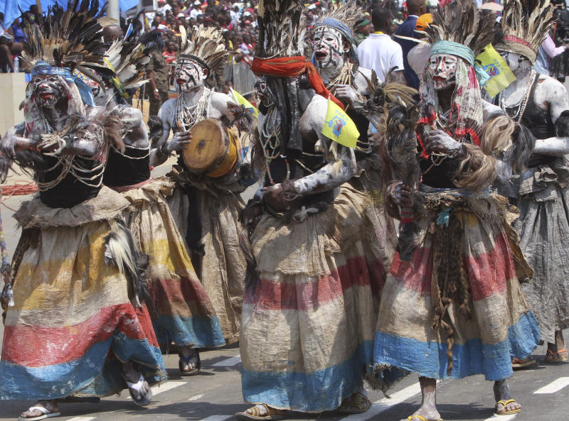 FILE - In this June 30 2016 file photo shot by AP contributing photographer John Bompengo, performers in traditional clothing celebrate the 56th anniversary of the Democratic Republic of Congo's independence from Belgium, in Kindu, Democratic Republic of Congo. Relatives say longtime Associated Press contributor John Bompengo has died of COVID-19 in Congo's capital. Bompengo, who had covered his country's political turmoil over the course of 16 years, died Saturday, June 20, 2020 at a Kinshasa hospital. (AP Photo/John Bompengo, file)