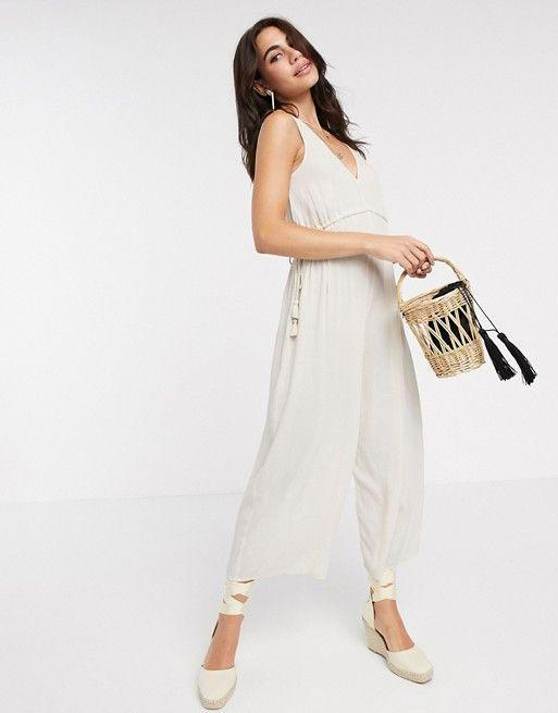 """<p><strong>Asos DESIGN</strong></p><p>us.asos.com</p><p><strong>$35.00</strong></p><p><a href=""""https://go.redirectingat.com?id=74968X1596630&url=https%3A%2F%2Fwww.asos.com%2Fus%2Fasos-design%2Fasos-design-lounge-minimal-wide-leg-jumpsuit-with-rope-channel-waist-in-cream%2Fprd%2F14264825&sref=https%3A%2F%2Fwww.goodhousekeeping.com%2Fbeauty%2Ffashion%2Fg32127704%2Fwhat-to-wear-to-a-baby-shower%2F"""" rel=""""nofollow noopener"""" target=""""_blank"""" data-ylk=""""slk:Shop Now"""" class=""""link rapid-noclick-resp"""">Shop Now</a></p><p>How cute is this linen jumpsuit? Grab a colorful clutch and a pair of fun espadrilles to add some flare.</p>"""
