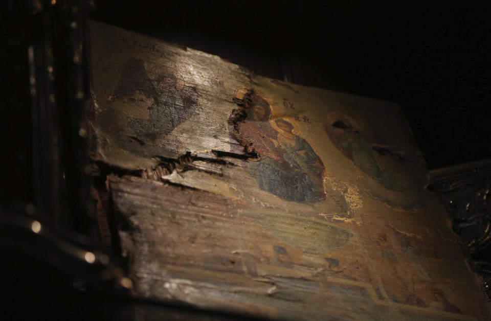 An icon recovered from the original St. Nicholas Greek Orthodox Church, destroyed in the Sept. 11, 2001 attacks, is preserved at the Greek Orthodox Archdiocese of America in New York on Wednesday, Aug. 18, 2021. (AP Photo/Jessie Wardarski)