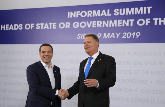 Greek Prime Minister Alexis Tsipras, left, is welcomed by Romanian President Klaus Werner Ioannis as he arrives for an EU summit in Sibiu, Romania, Thursday, May 9, 2019. European Union leaders on Thursday start to set out a course for increased political cooperation in the wake of the impending departure of the United Kingdom from the bloc. (AP Photo/Vadim Ghirda)