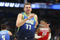 Dallas Mavericks forward Luka Doncic (77) reacts after hitting a three-pointer in the second half against the Sacramento Kings in an NBA basketball game Sunday, Dec. 8, 2019, in Dallas. (AP Photo/Richard W. Rodriguez)