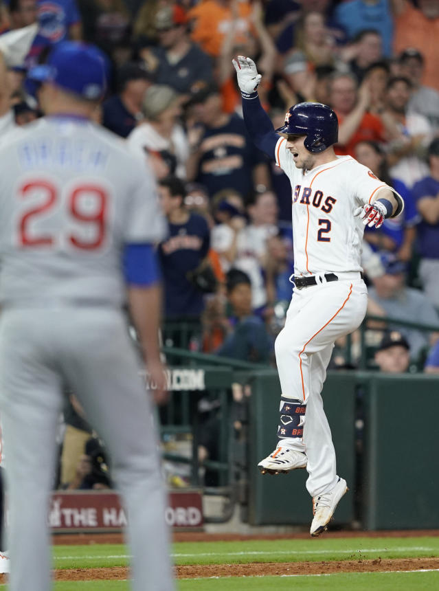 Houston Astros' Alex Bregman (2) celebrates after hitting a two-run home run off Chicago Cubs relief pitcher Brad Brach (29) during the sixth inning of a baseball game Tuesday, May 28, 2019, in Houston. (AP Photo/David J. Phillip)
