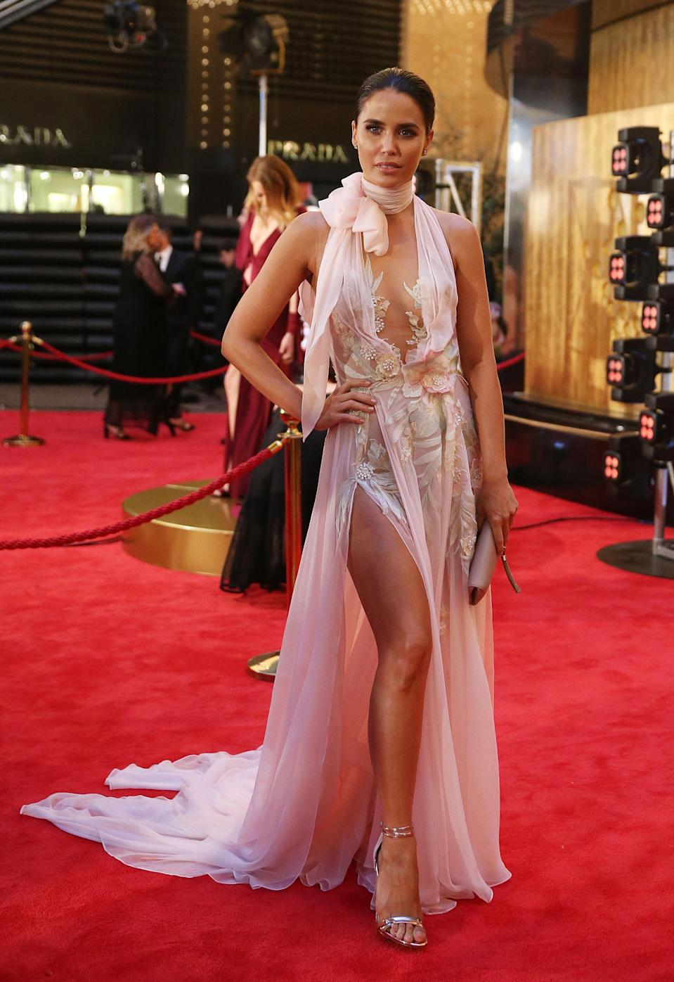 Like Bec Judd, fellow attendee Jodi Anasta's frock should work on paper - but just doesn't hit the mark. The actor-turned-WAG looks swamped in layers of floaty chiffon, and the tie detail at the neck seems like overkill. Photo: Getty Images.