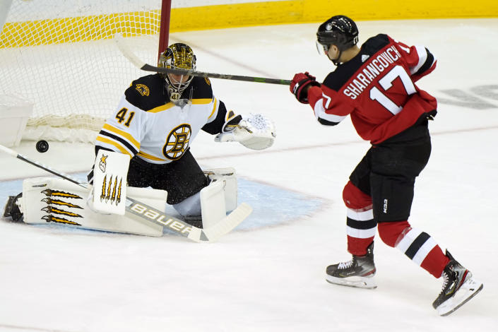 Boston Bruins goaltender Jaroslav Halak (41) makes a save on a shot by New Jersey Devils center Yegor Sharangovich (17) during the first period of an NHL hockey game, Tuesday, May 4, 2021, in Newark, N.J. (AP Photo/Kathy Willens)