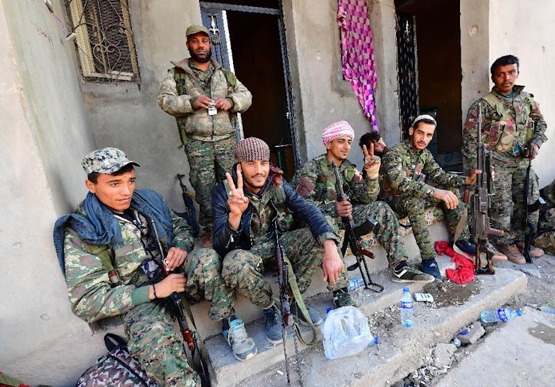 Many of the Syrian Democratic Forces fighters are now returning home to their families to enjoy early leave for this week's Kurdish New Year holiday, their frontline duties over and their mission all but accomplished (AFP Photo/GIUSEPPE CACACE)