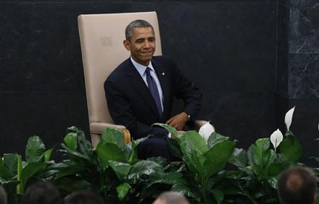 U.S. President Obama takes his seat after arriving to address the 68th United Nations General Assembly in New York