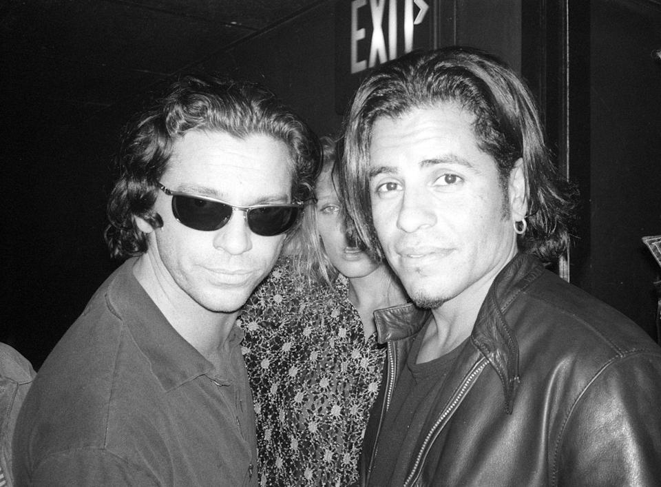 <p>Michael Hutchence of INXS and guitarist Stevie Salas pose for a portrait at the Nicklebag concert at the Viper Room in Los Angeles, California on November 5, 1997.</p>