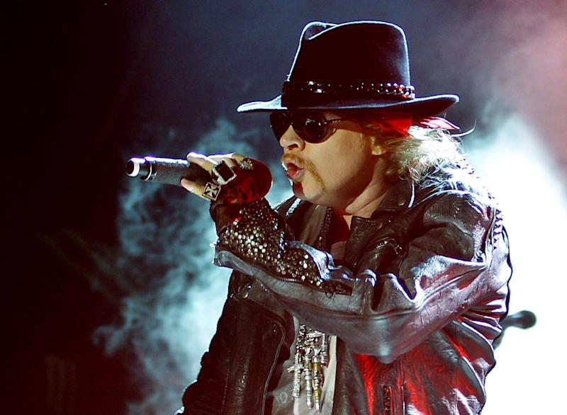 """FILE - This Dec. 7, 2012 file photo shows Axl Rose, lead vocalist of Guns N' Roses performing during their concert in Bangalore, India. A judge on Wednesday Feb. 20, 2013 dismissed Rose's lawsuit against Activision Blizzard Inc. The Guns N' Roses rocker had claimed the gaming giant violated an agreement not to feature guitarist Slash in a """"Guitar Hero"""" video game. (AP Photo/Aijaz Rahi, file)"""