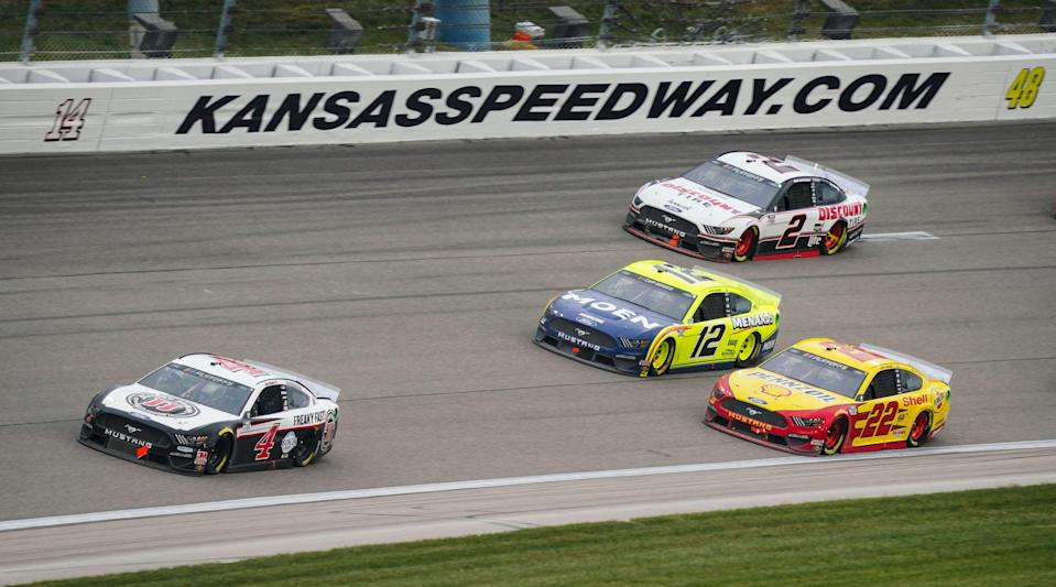 Kevin Harvick (4) leads a trio of Team Penske drivers, Joey Logano (22), Ryan Blaney (12) and Brad Keselowski (2), during the 2020 playoff race at Kansas Speedway.