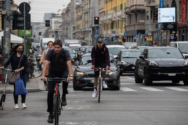MILAN, ITALY - SEPTEMBER 23: People ride bicycles on a pop-up bike lane on Corso Buenos Aires on September 23, 2020 in Milan, Italy. Since the end of lockdown Milan authorities have added a further 35 kilometers of pop-up bike lanes and cycle paths and encouraged cycling and riding e-scooters as a safer form of transport away from jam-packed buses or subway trains, in order to promote social distancing in response to COVID-19. (Photo by Emanuele Cremaschi/Getty Images) (Photo: Emanuele Cremaschi via Getty Images)