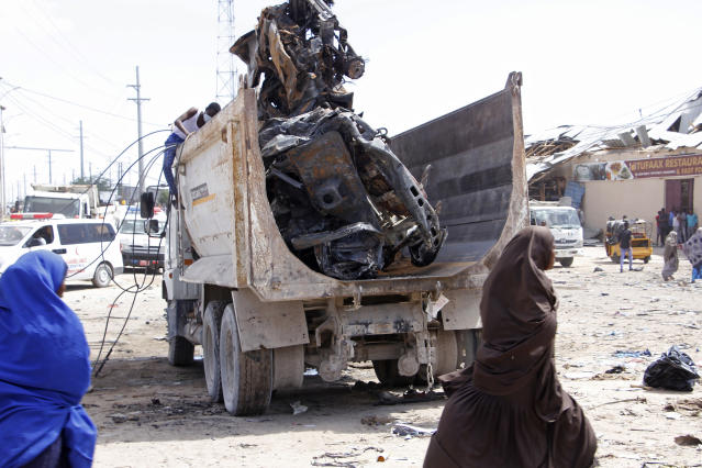 A truck carries wreckage of a car used in a car bomb in Mogadishu (Picture: AP)